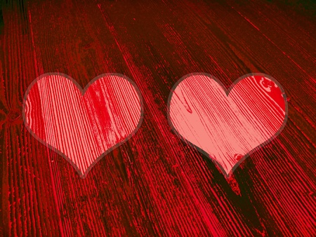 romaticism: Pair of red hearts on old wood background Stock Photo