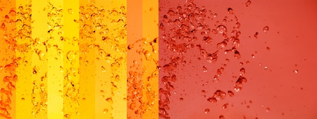 colortherapy: Warm tangerine red background and yellow banners with liquid splashing Stock Photo