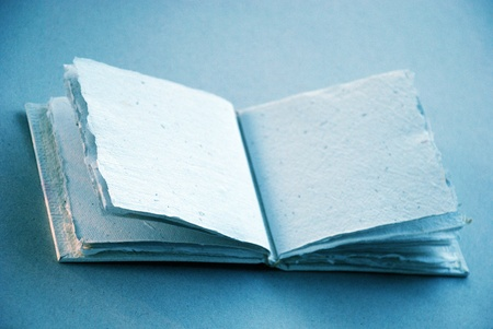 Soft light blue clear sketch book to write or draw a note Stock Photo - 12426910