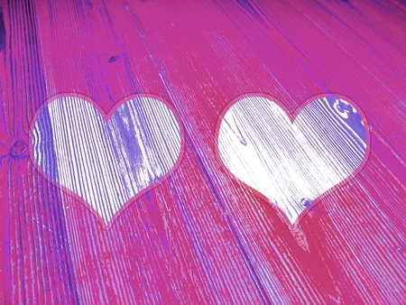 Pair of hearts on purple wood background for valentines photo