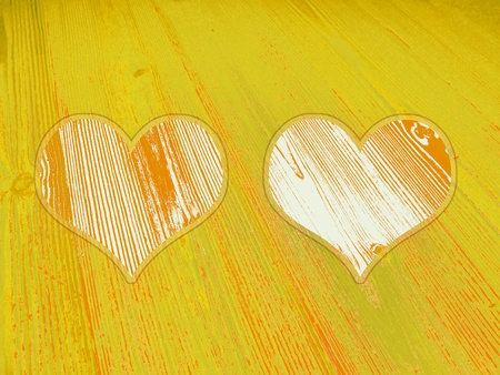 romaticism: Yellow old wood background with couple of hearts Stock Photo