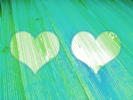 Fresh green wood background with two hearts photo