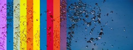 A rainbow of banners backgrounds and blue water background toghether photo