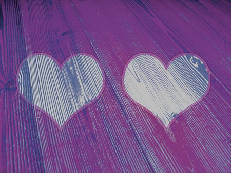 romaticism: Two hearts on vintage striped wood purple and blue background