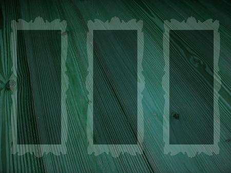 Empty rectangular frames in dark green old wood background