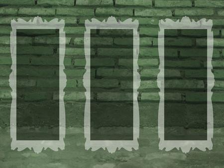 Green rustic brickall with three empty transparent frames photo