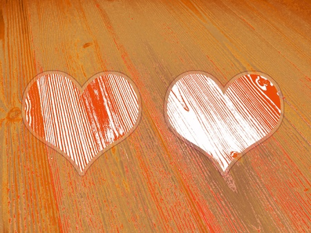 Couple of hearts on old wood striped orange background photo