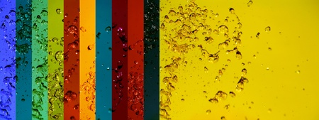 solarize: Yellow background with multicolored banners backgrounds all with liquid drops splash