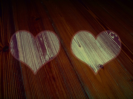 romaticism: Old striped wood dark surface with two hearts frames lighther in beige and brown Stock Photo