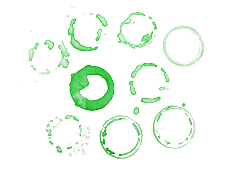 Green collection of circles of dried liquid isolated on white background photo