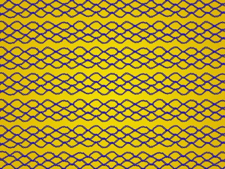 sophistication: Blue chain link linked in crochet laces on gold yellow background Stock Photo
