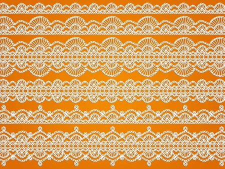 sofisticated: White crochet waves and laces isolated on orange background Stock Photo