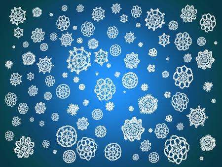 similitude: Crocheted snowflakes isolated over dark blue luminous background Stock Photo