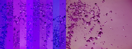 aura soma: Luminous indigo blues and violet banners and purple backgrounds with liquid drops splash in them Stock Photo