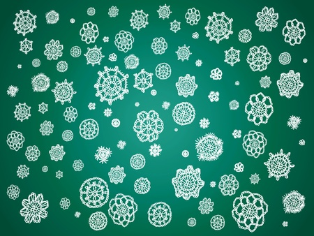 misteries: Dark green Christmas background with white delicated snowflakes of crochet falling Stock Photo
