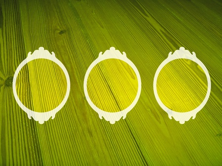 olive green: Yellowish green circular wood frames over olive green background