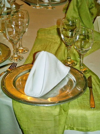 aniversaries: Soft elegant green table set with silver plate on a marriage celebration