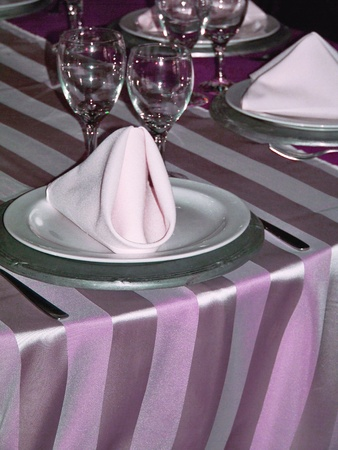 aniversaries: Glossy delicacy on elegant dinner table in white, silver and lilac purple with brightness and transparencies
