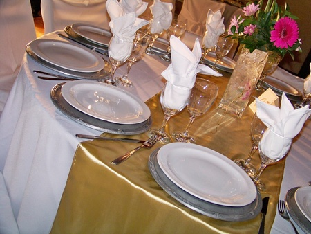 Elegant sophisticated wedding table in brilliant gold, silver and white photo