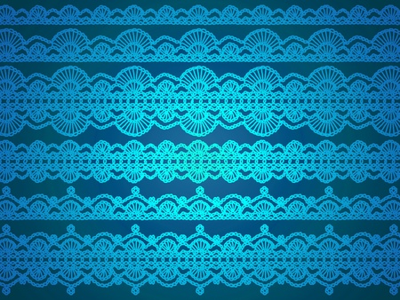 Luminous turquoise crochet lace fabrics over dark blue background photo
