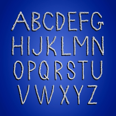 Crochet alphabet letters in white isolated over blue photo