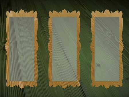 Three rectangular blank transparent frames for pictures over old wood dark green background photo