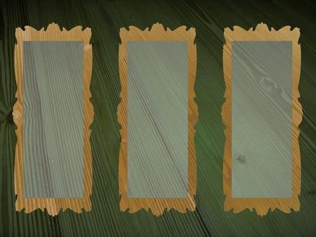 fondo verde oscuro: Tres marcos rectangulares en blanco transparente para las im�genes sobre fondo verde antiguo de madera oscura Foto de archivo