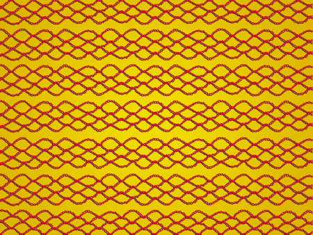 Simple red crochet laces pattern on golden yellow background photo