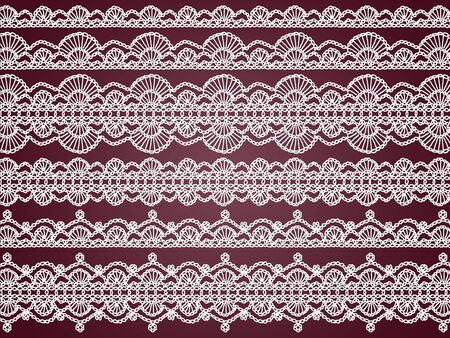 Antique crochet laces in white fabrics over dark purple background photo