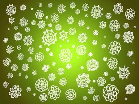 similitudes: White crochet flowers over light green backdrop Stock Photo