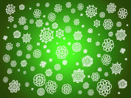 Christmas background with traditional crochet details as flowers or snowflakes over luminous green Stock Photo