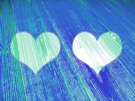 romaticism: Two hearts on blue old wood striped background
