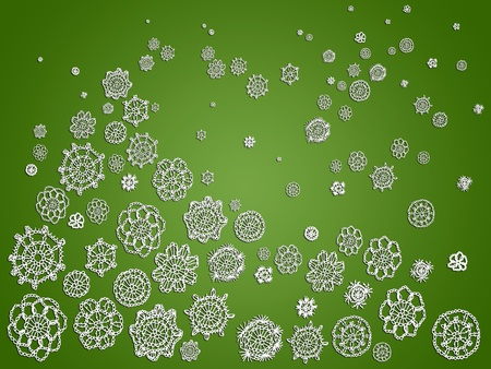 Green background with white crochet patterns like an abstract Christmas background photo