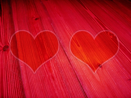 Red background with heart shapes over old striped wood photo