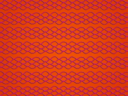 Red crochet laces over dark orange background photo