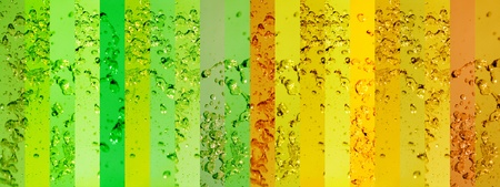 solarized: Green and yellow banners with splashing drops of water in a long background Stock Photo