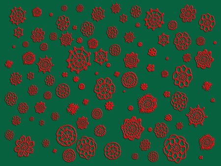Vintage red crochet flowers isolated over green background photo