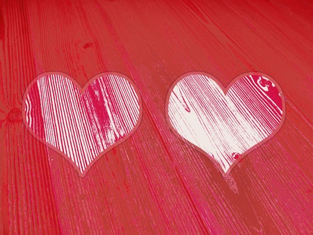 Two red hearts for valentine day on an old wood surface photo