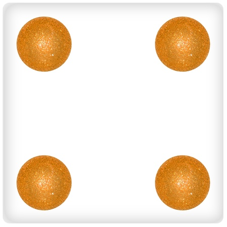 Four golden yellow xmas balls on a dice game face photo