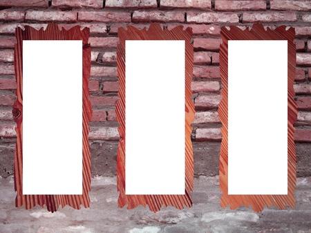 Brickwall with three empty blank frames