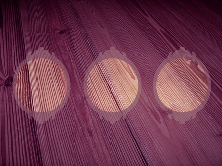 Purple background of old striped wood with three transparent circular empty frames shapes photo