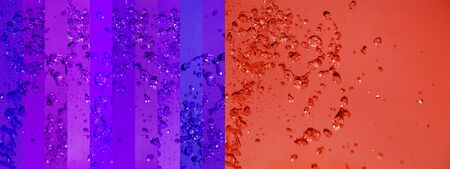 aura soma: Orange and purple intense contrast in a background with banners with water drops splash