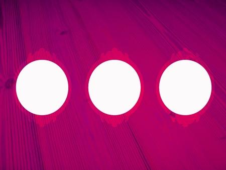 purpleish: Pink wood background with three circular empty frames Stock Photo