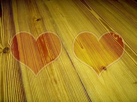 romaticism: Two heart silhouettes on old striped yellow wood Stock Photo