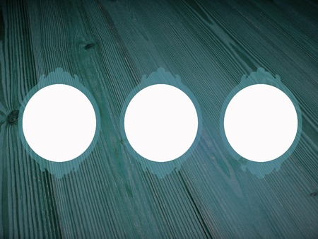 Dark sober blue old wood background with three circular empty frames Stock Photo - 13524946