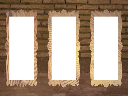 Brown brickwall background with three rectangular empty frames photo