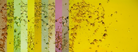 Yellow background with liquid water drops Stock Photo - 25151424