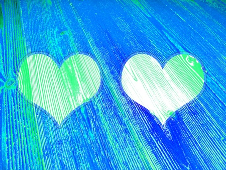 romaticism: Two light hearts over blue old striped wood Stock Photo