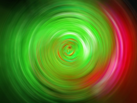 Green light swirling with pink on black backdrop photo