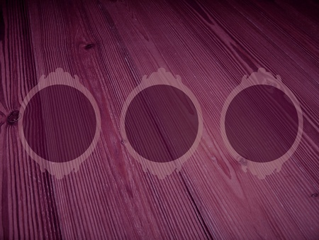 Vintage circular empty frames over old wood in purple photo